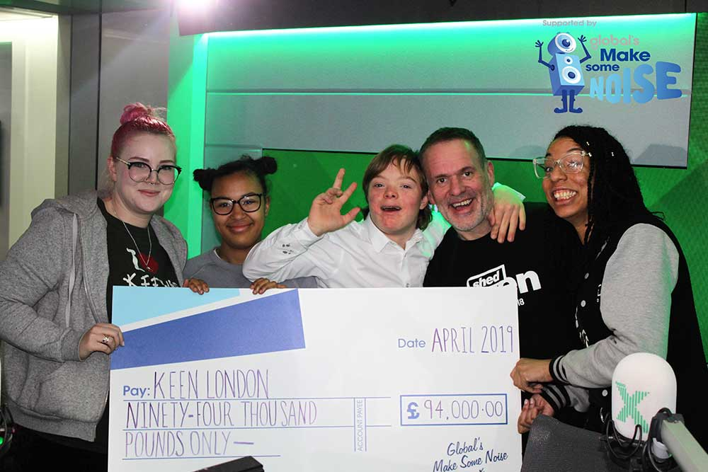 KEEN London receive a cheque for £94,000 from Global's Make Some Noise